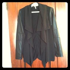 """Drapey cardigan with faux leather sleeve accents Measures about 18"""" across at armpits and 19"""" from top to bottom. Shell is 100% polyester. Machine wash. There is rouching up the center of the back and at the sides. Studio Y brand purchased at Maurices. Size large. Studio Y Jackets & Coats"""