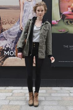 grey shirt + black hoodie + anorak, parka, military jacket + black shorts + tights + ankle boots : layering, fall outfit