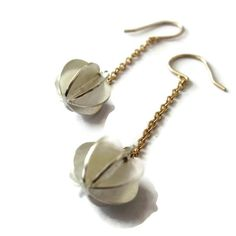 Visibly Interesting: Dangle earrings with Sterling Silver bubble charms on solid 14K gold chain and wires. Handcrafted by Sheri Beryl whose work is focuses on the timelessness of clean sophisticated everyday style.