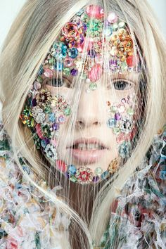 Bejeweled and embellished/karen cox.... Colourful jewel-studded face with hair blown forwards across it mimicking a veil of sorts.