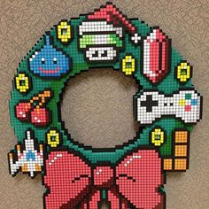 8 Bit LED Wreath - Change the boring traditional Christmas decoration into a rare pearl for every retro-gaming fan! #Christmas #geek #gadget www.junkpeoplebuy.com