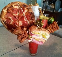 This Bloody Mary hooked up with pizza, a footlong sub, and another Bloody Mary at the same time. | 21 Bloody Marys That Blurred The Line