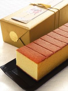 """Castella is a popular Japanese sponge cake type wagashi made of sugar, flour, eggs, & starch syrup. Now a specialty of Nagasaki, the cake was brought by way of Portuguese merchants in the 16th century. The name is derived from Portuguese Pao de Castela, meaning """"bread from Castile"""". Castella cake is usually sold in long boxes. This castella is from the famous sweets shop Ginza Bunmeido located in Ginza, Tokyo."""