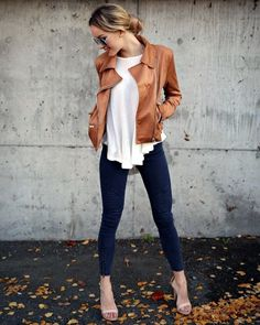 Love the brown leather jacket with the white top, dark wash skinnies, and sandals.