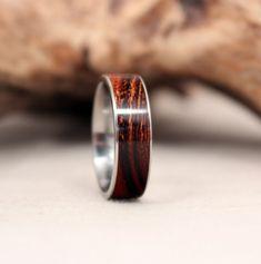 Titanium and Arizona Desert Ironwood Wooden Ring Titanium Ring. $205.00, via Etsy.