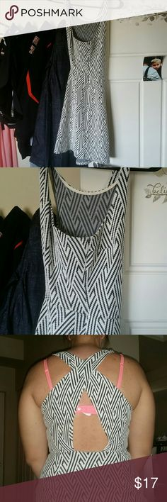 Dress White and black tank top dress. Criss cross in the back. Fits tight.  Worm once.  Great condition Hollister Dresses Mini