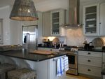 Kitchen from beachhouse in Holden.  Like the not-white, not-grey cabinets as well as other finishes