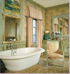 Charles Faudree upholstered the walls with fabric in this decadent master bathroom