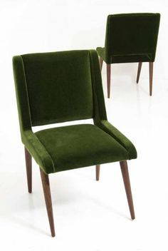 For the Mid Century modern home, these dining chairs are the perfect accent for your dining room. Upholstered in gorgeous Emerald Mohair with solid walnut legs and a sleek cut out at the bottom of the