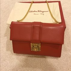 "NWT Salvatore Ferragamo small chained bag new with tag small chained handbag or big chained wallet.   measurements :7.5""*5.5 strap with a drop from top 9'5""   comes with original dusk bag, box, tag/care card Salvatore Ferragamo Bags Clutches & Wristlets"