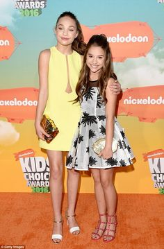 Stylish siblings: Maddie Ziegler put an arm around sister Mackenzie, 11, as they arrived at the Nickelodeon Kids' Choice Awards on Saturday