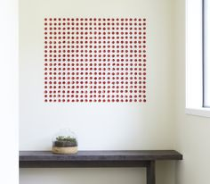 "ReCheng Tsang | discs : red | glazed porcelain on wall | 48"" x 36"", 2011"