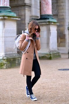 justthedesign:  A camel coloured coat and black skinny jeans go...