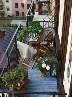 small-balcony-design-ideas I like the rug and the plants but would kepp the chairs closer to the wall.
