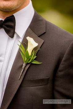 The groom's boutonniere matched the graceful bridal bouquet created from white calla lilies. More photos: https://www.facebook.com/xquisiteflowersandevents/posts/1081515951914624 #WeddingFlowers by @xquisiteflowers