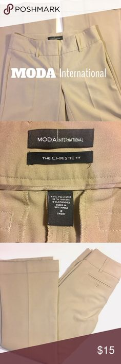 MODA INTERNATIONAL DRESS PANTS The Christie Fit. Tan in color. Size 2 SHORT. Straight leg. Pleated and cuffed. 63% polyester, 33% viscose, 4% spandex. Moda International Pants Straight Leg