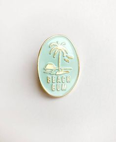 Wheere your beach bum status loud and proud!Dimensions pins approx Blue enamel and gold metal plating. Beach Puns, Jacket Pins, Pin And Patches, Cute Pins, Pin Badges, Lapel Pins, Pin Collection, Beach Bum Style, Enamels