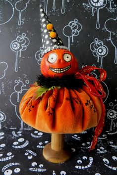 .. remember these ?....well one is finished... meet Mr Pumpkin Head..all painted and with his new hat on.His body is made from a circle of o...