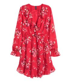 Red/floral. Short dress in airy chiffon with a attached wrapover front. Flounce-trimmed V-neck, elasticized seam at waist, elasticized, flounced cuffs, and