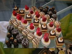Petit four display idea: a little chocolate, a little strawberry, hazlenut and vanilla cream: yum!