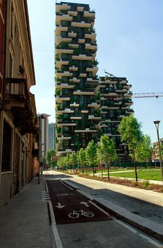 A pair of skyscrapers by Milan office Boeri Studio are nearing completion in the Italian city, featuring as many trees as could be planted in a hectare of forest.