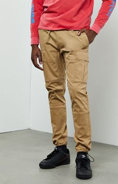 Stay on trend in these street-style-approved pants by PacSun. The Workwear Khaki Slim Fit Cargo Pants have just the right amount of stretch, front and back pockets, cargo pockets on the sides, adjustable ankle cuffs, and a versatile solid khaki wash. Slim Fit Cargo Pants, Cargo Work Pants, Jogger Pants, Khaki Pants Outfit, Mens Dress Pants, Business Casual Men Khakis, Pacsun Mens, Mens Work Pants, Champion Sweatpants