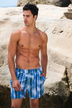 Sauvage Swimwear Royal Stripe Swimmer - European Beach Shorts - Washes of white add a fading effect to these vintage-style swim trunks cut with a contemporary length. For anyone seeker a bit more coverage, this piece from Sauvage Swimwear's 2015 designer collection is constructed with a longer inseam and length. They are modest enough to look appropriate at any waterside setting but short enough to show off a pair of strong legs. #beachshorts