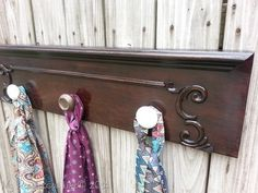 From drawer front to coat rack. Love this look for a jewelry organizer too.
