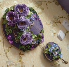 Silk ribbon embroidery on purple wood plaque