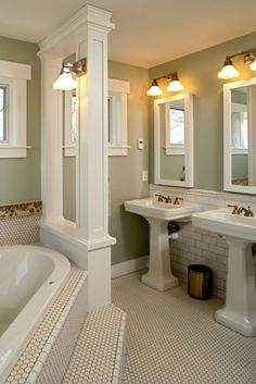 I want to change out our bathroom mirror for two smaller mirrors like this and add the lighting- love it