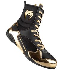 Venum Elite Boxing Shoes - Black/GoldAfter two years of research and development,VENUMis proud to present our firstprofessional boxing shoe. TheElite boxing shoesare the result of strategic research, development and collaboration betwe. Boxing Boots, Boxing Gloves, Boxing Boxing, Martial, Professional Boxing, Boxing Champions, Wrestling Shoes, Boxing Training, Gold Shoes