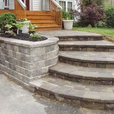 Renovated house entrance way - new retaining wall, walkway, and paver steps in the Rochester - Rochester Hills MI area | Yelp