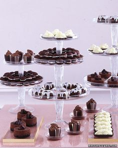 Chocolate Bar A selection of diminutive chocolate desserts can be served alongside a wedding cake. Clear cake stands and trays trimmed in gold ribbon showcase the rich dark and white chocolate.