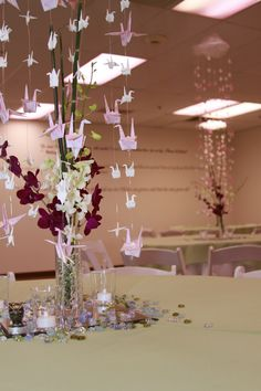 Close up of the origami and orchid table decorations.