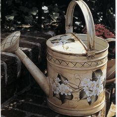 decorated watering can