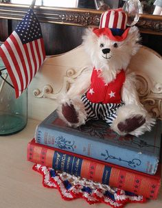 Vintage books, doily / Flickr  #patriotic #americana #flag #july4th #decor #bear #unclesam #books #antique #vintage #red #blue #stars #stripes #doily