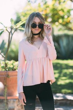 """We are in love with the sweet peachy shade of the Kaleigh Babydoll Top! *Item measures 25"""" from front neck to hem and 28"""" from back neck to hem."""