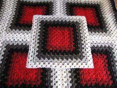 This is an illusion squared 3D crochet blanket using the granny stitch. There is a symbols charts to follow to make this. Looks pretty simple.