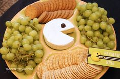 Cheese platter with fruit (minus crackers) --> With tillamook cheese as pac man