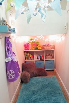 Creating a Playroom in a Closet small home living tiny homes small spaces Organizing your home kids toy storage childrens play room Rain and Pine