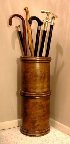 I want something like this for the entry - antique walking canes. Love it!