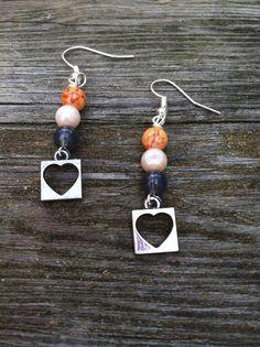 Silver heart dangle earrings on Etsy, $12.00