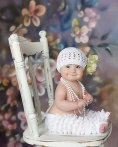 A girl is never too young to wear pearls and lace.  Just Adorable...Little Girls love Dress up...Go to Goodwill or Salvation Army and Fill up a huge box and help them Dress Up and let them pose for pix....They'll love it......