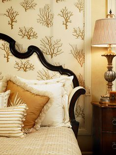 Bedroom - The coral wallpaper mirrors the headboard....calm & muted palette with a traditional touch..
