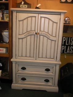 Armoire painted Antique White with brown glaze. I SERIOUSLY love this finish!!! My DREAM kitchen has cabinets like these <3