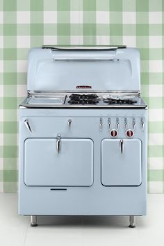 Built-in cabinets with standardized sizes for stoves first appeared in kitchens during the 1950s. At 37.5 inches wide, this 1952 Chambers is more representative of this shift in size. Value: $7,400   - CountryLiving.com