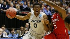 #NBA DAYTON, OH - MARCH 18:  Semaj Christon #0 of the Xavier Musketeers drives against Desmond Lee #5 of the North Carolina State Wolfpack in the first half during the first round of the 2014 NCAA Men's Basketball Tournament at at University of Dayton Arena on March 18, 2014 in Dayton, Ohio.  (Photo by Gregory Shamus/Getty Images)