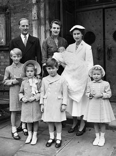 The christening at Hampstead Church, July 5, 1954, of Lady Virginia FitzRoy. Here are the Earl of Euston, HM The Queen, Viscount Ipswich, Lady Henrietta FitzRoy, The Duke of Cornwall (aka Prince Charles) and Princess Anne. The Queen was godmother.