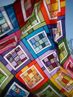 scrappy quilt  .. no tutorial, but easy to do, and looks like stained glass!
