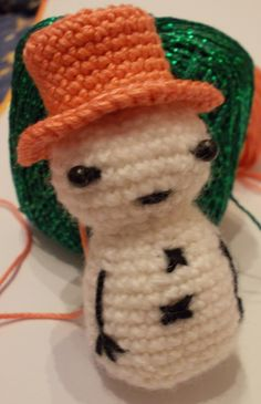 Crochet snowman ornament with a hat